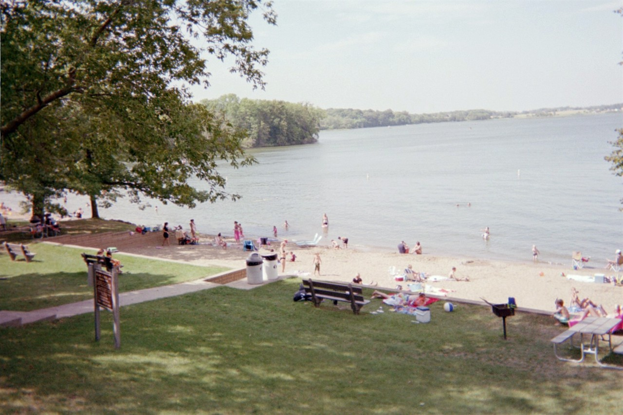 image of lake beach with people
