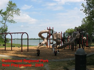 image of an empty playground with slides and swings